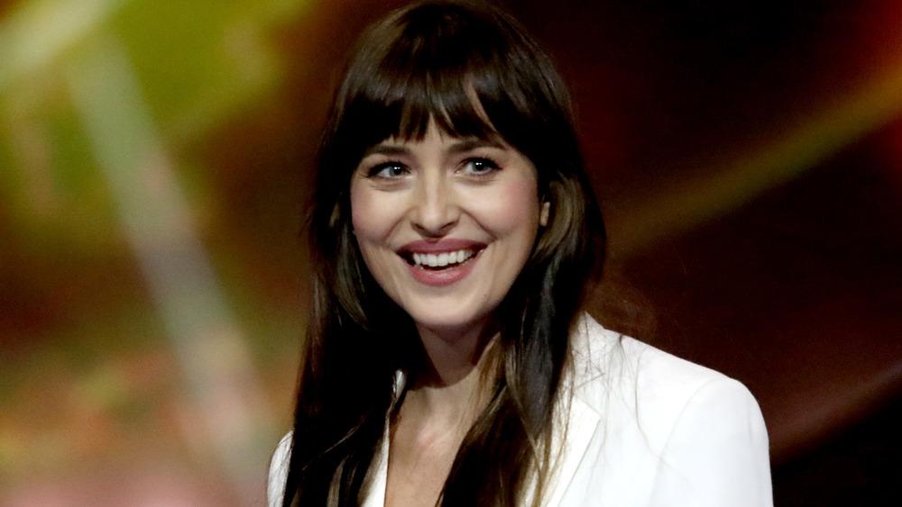 Dakota Johnson smiling broadly