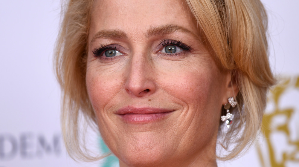 Gillian Anderson grinning