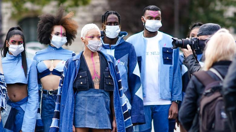 Models being photographed at Paris Fashion Week