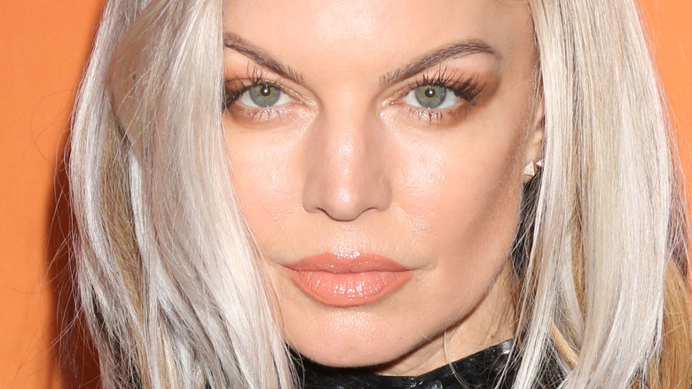 Fergie stares with brown eyeshadow and lipgloss.