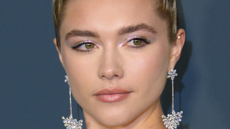 Florence Pugh poses on the red carpet