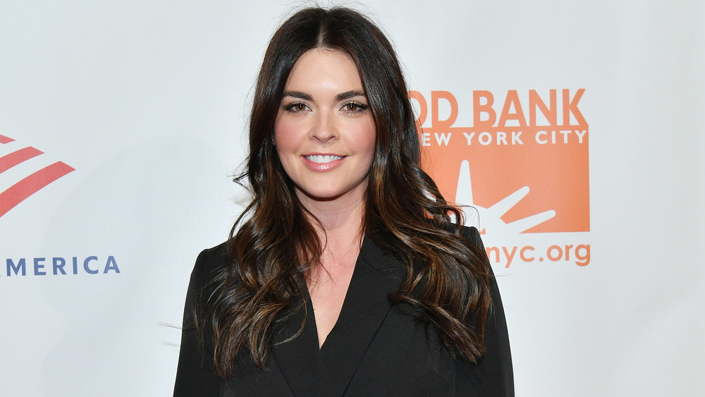Katie Lee smiling in black