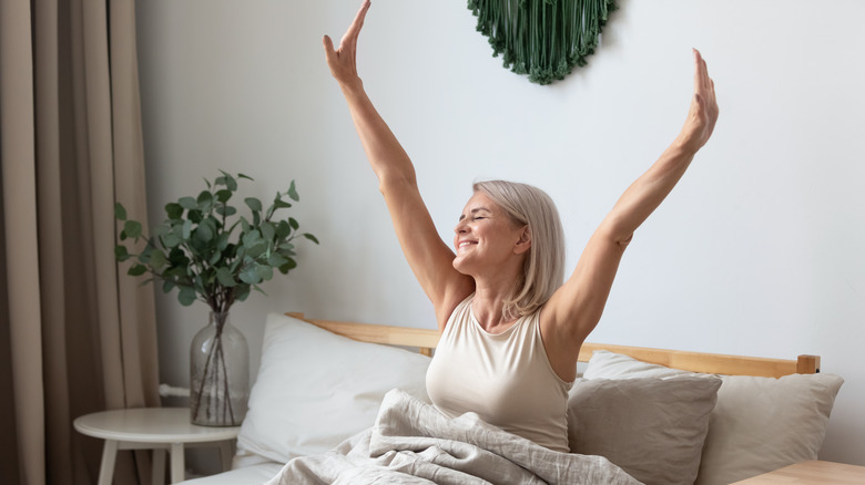 woman waking up in bed