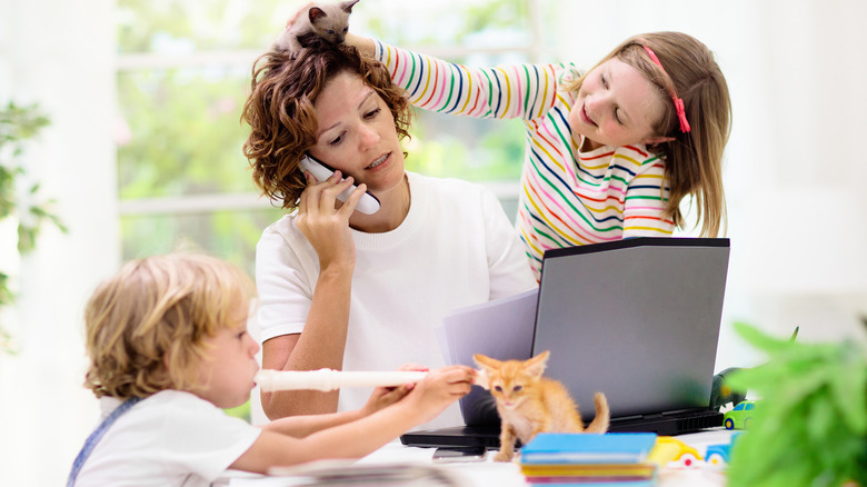 Woman trying to work with kids