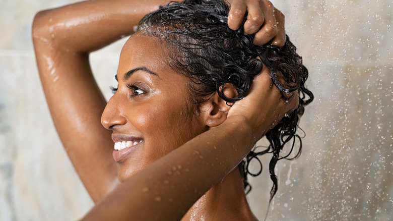 Woman using conditioner