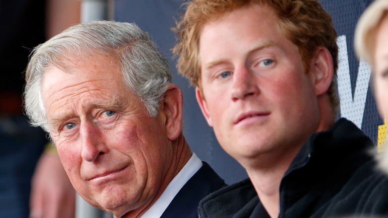 Prince Harry with father Prince Charles.
