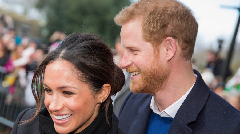 Prince Harry and Meghan Markle smiling