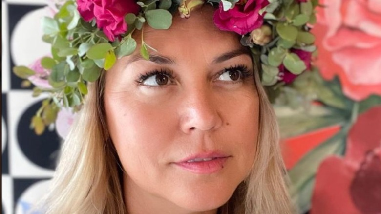 Jenny Nashama Barker posing with floral headpiece