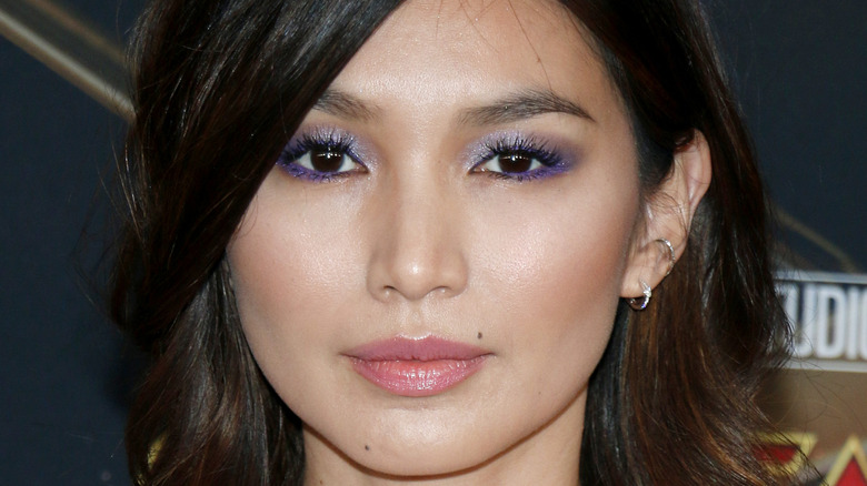 Gemma Chan posing for a picture on the red carpet