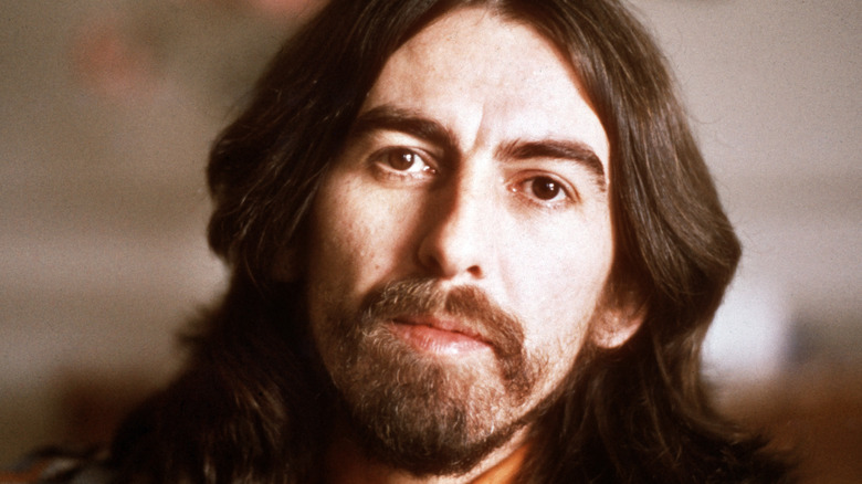 George Harrison posing