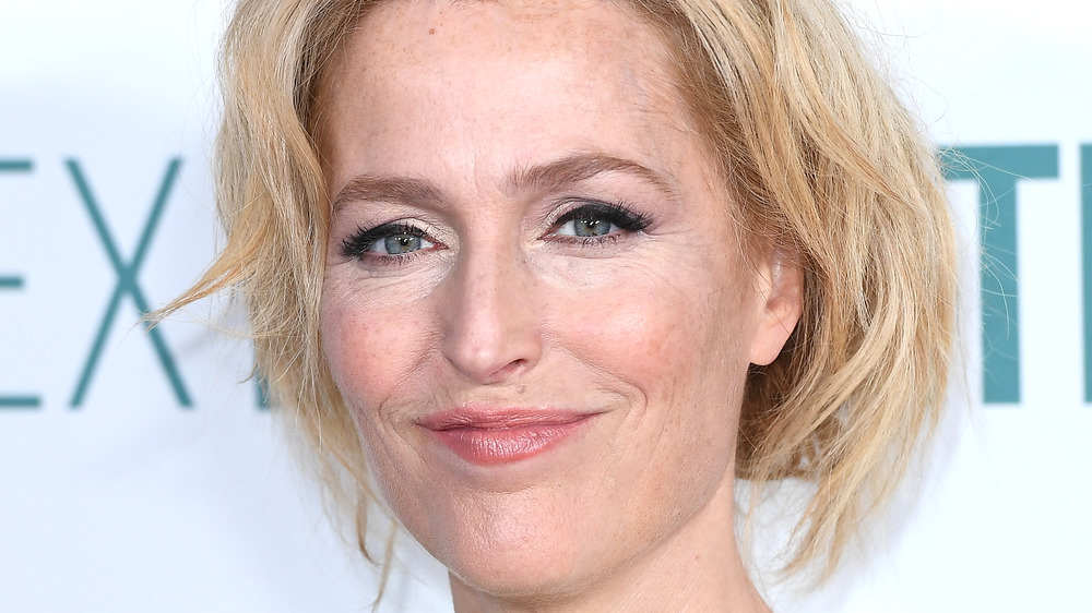 Gillian Anderson smiling on red carpet