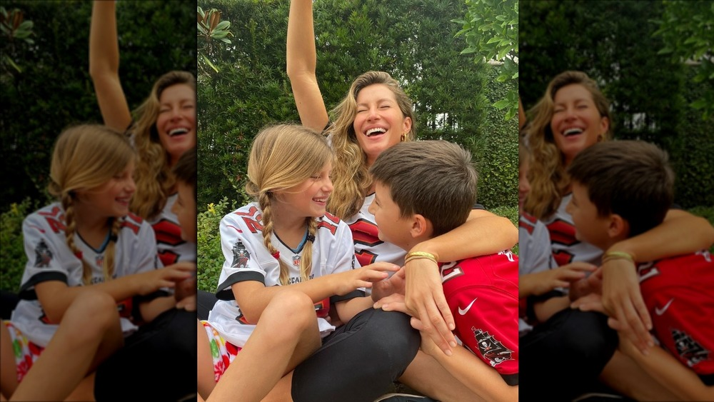 Gisele Bündchen cheers with her kids