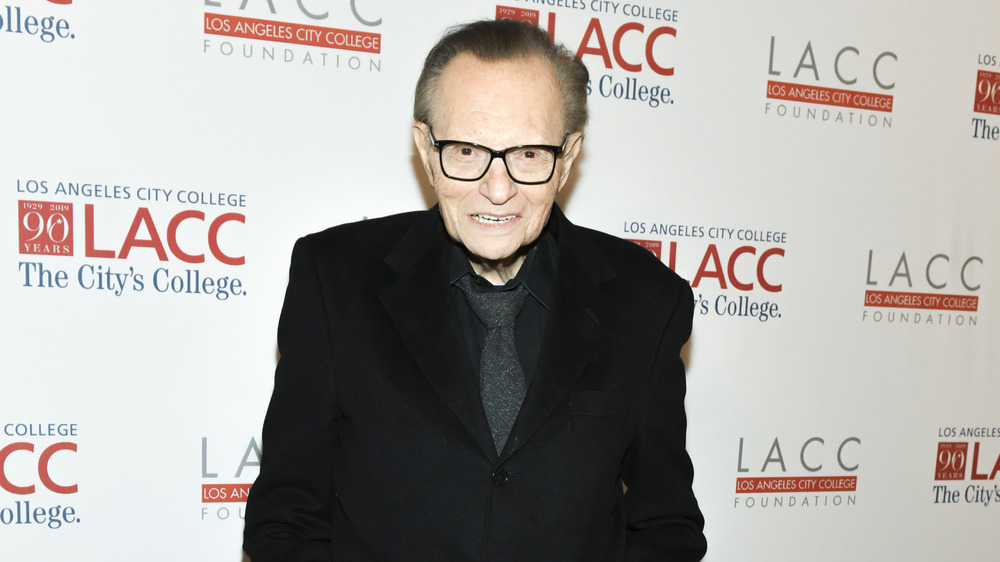 Larry King in black suit at event