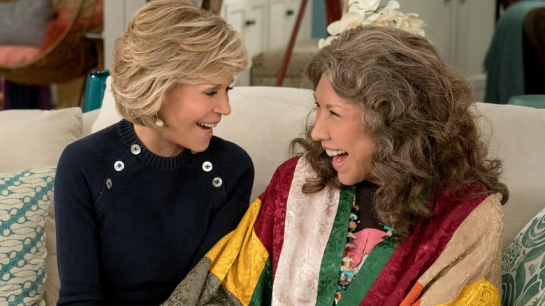 Lily Tomlin and Jane Fonda on a couch in Grace and Frankie
