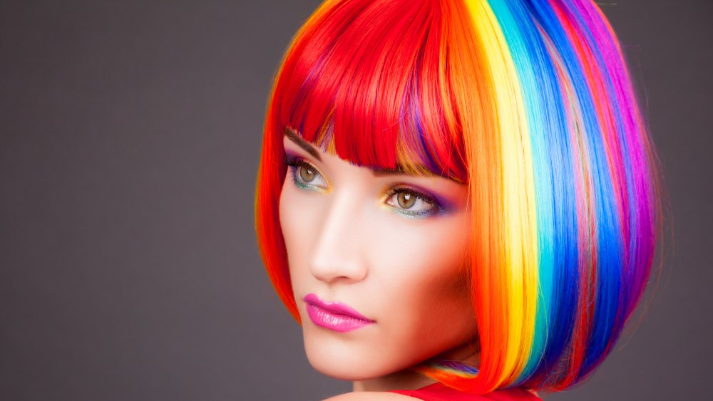 A woman with rainbow colored hair