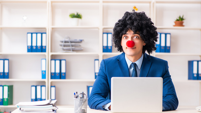 Clown wig and nose, office setting