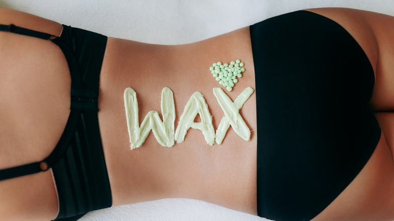 woman with wax on her back