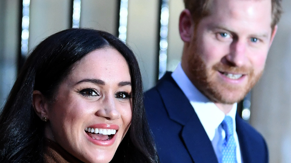 Meghan and Harry smile