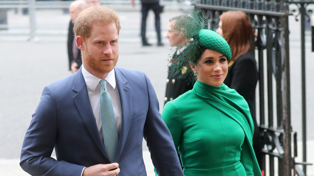 Meghan Markle in green dress with Prince Harry