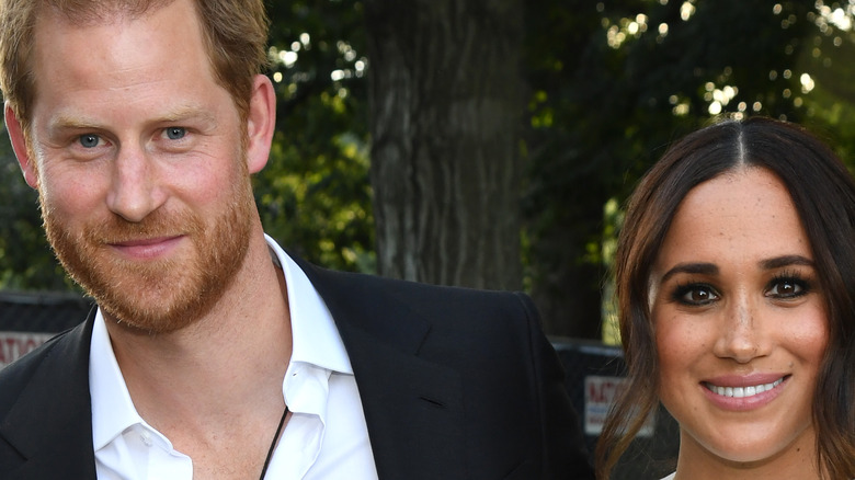 Prince Harry and Meghan Markle smiling in NYC