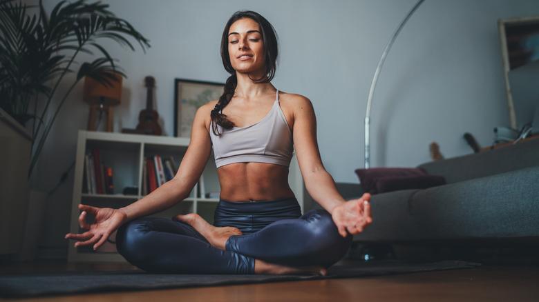 Woman in sports bra meditating