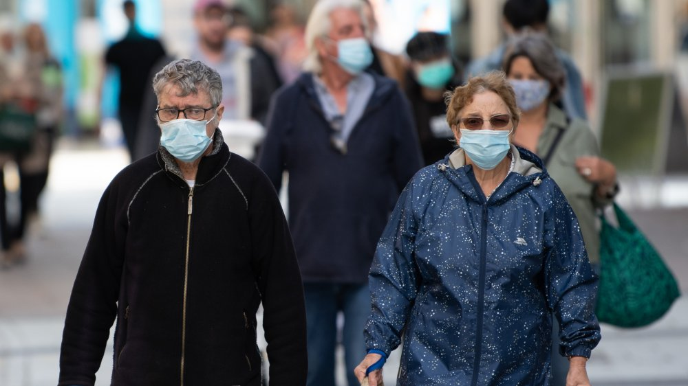 People on the street with masks on