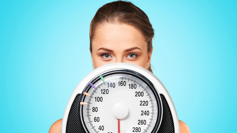 Lose weight woman with scale