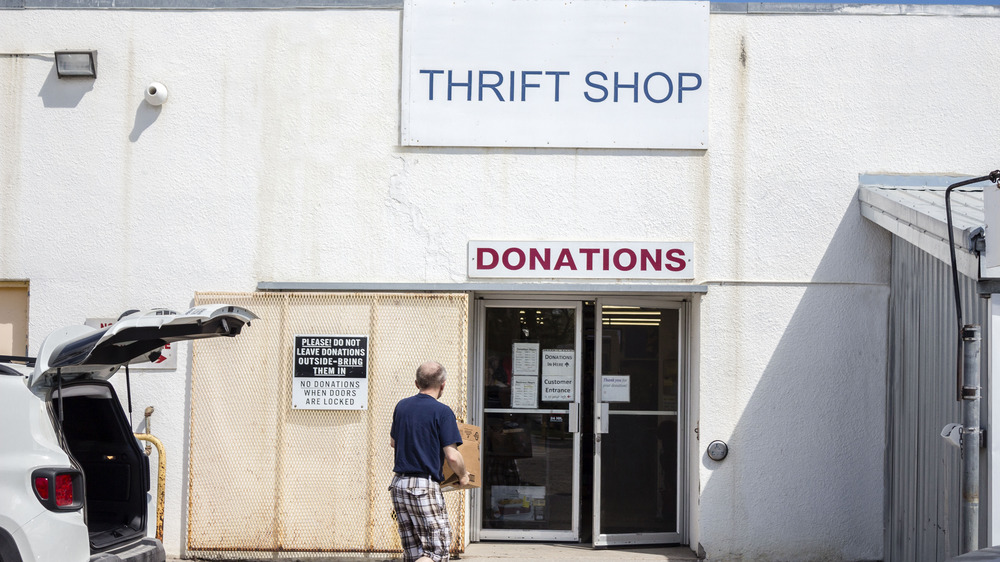 Someone donating to Goodwill