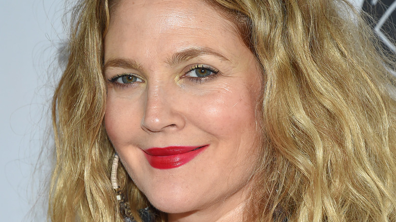 Drew Barrymore grinning with red lip