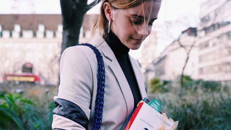 Emma Watson with book