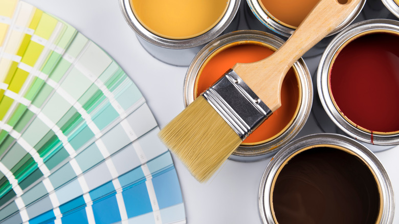 A paint brush and paint colors