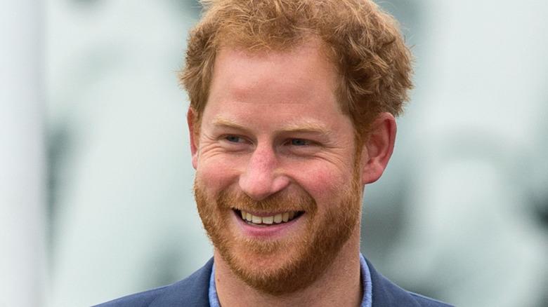 Prince Harry wears a dark blue suit