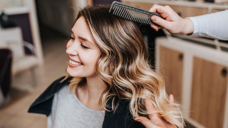 Woman with balayage hair smiles