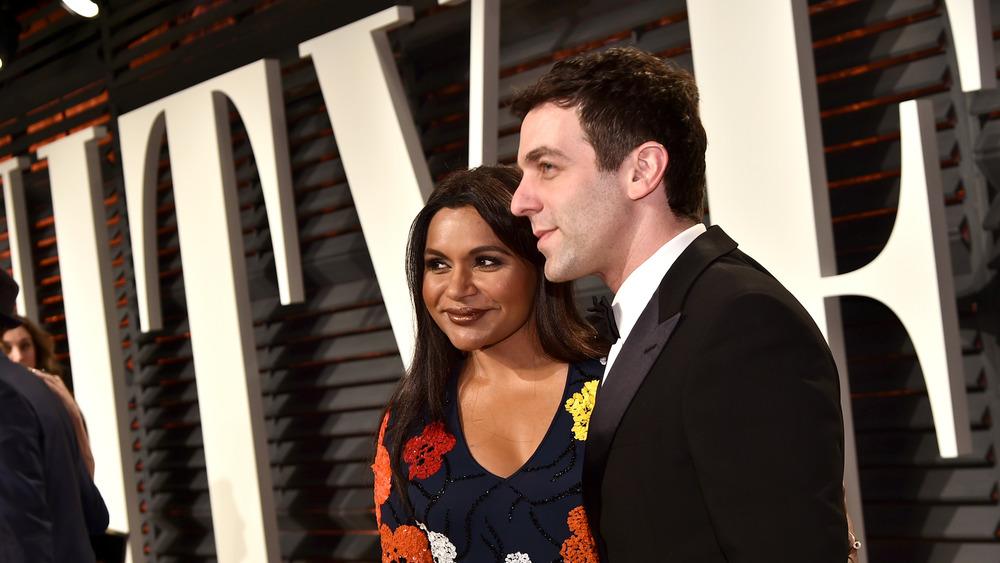 Mindy Kaling and BJ Novak posing at Vanity Fair Oscar party