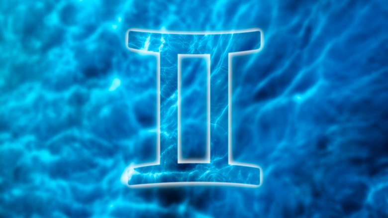 Gemini sign, water background