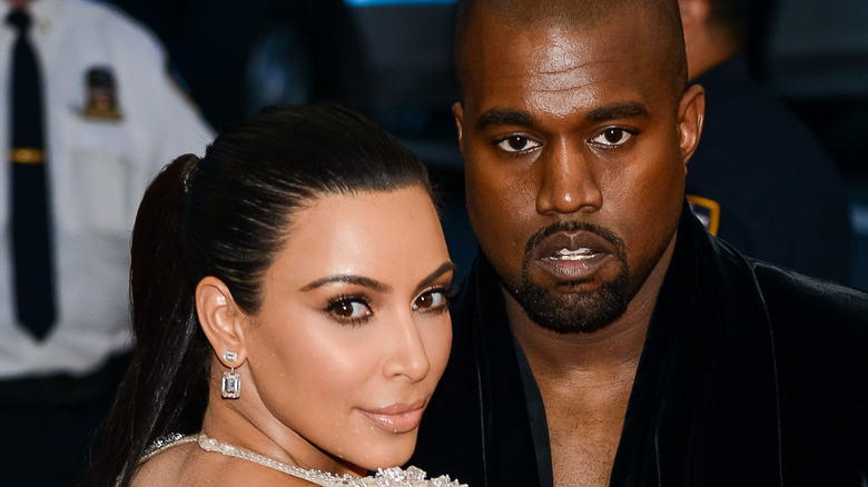 Kim Kardashian and Kanye West at an event.