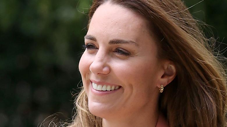 Kate Middleton smiling during royal duties