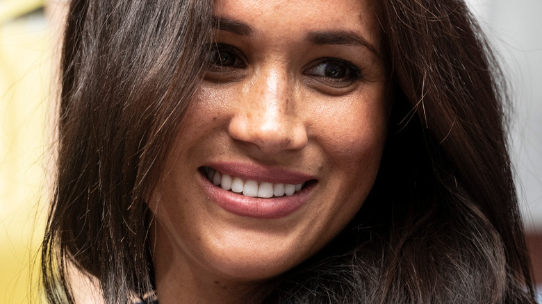 Meghan Markle poses with smile
