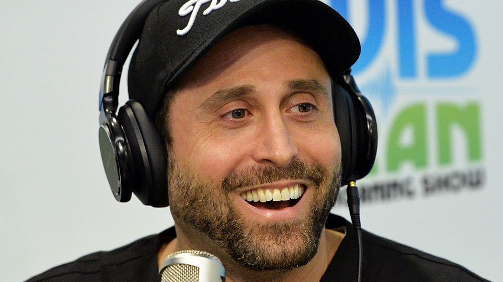 Dr. Miami smiles at microphone