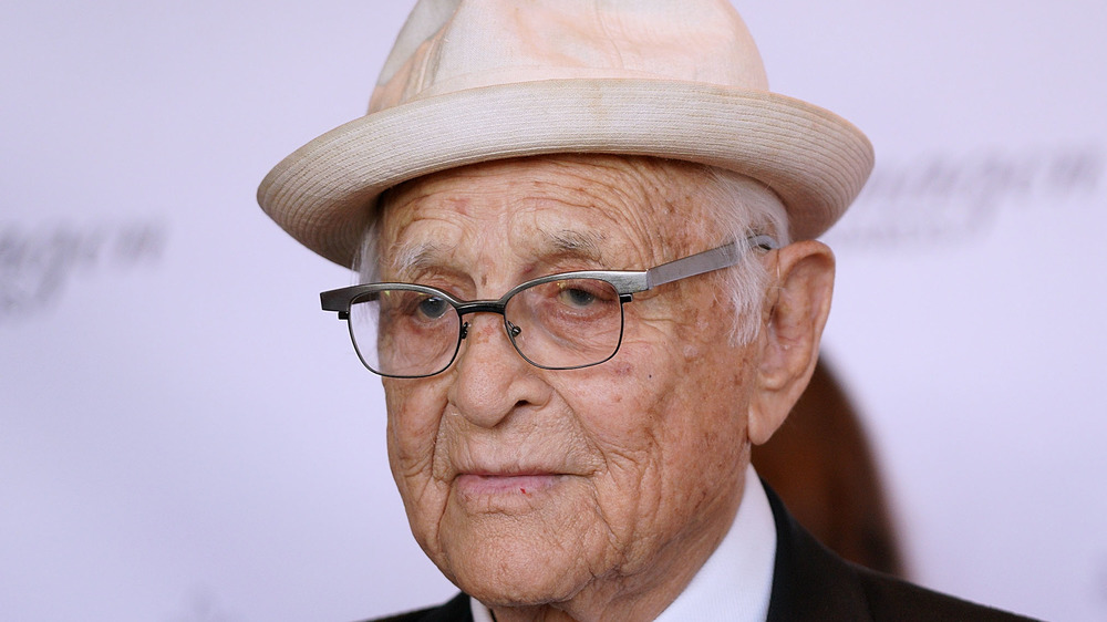 Norman Lear poses on the red carpet