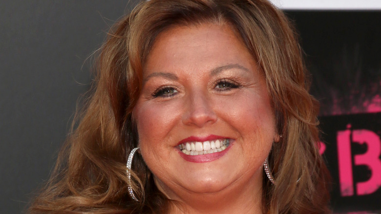 Abby Lee Miller posing at event