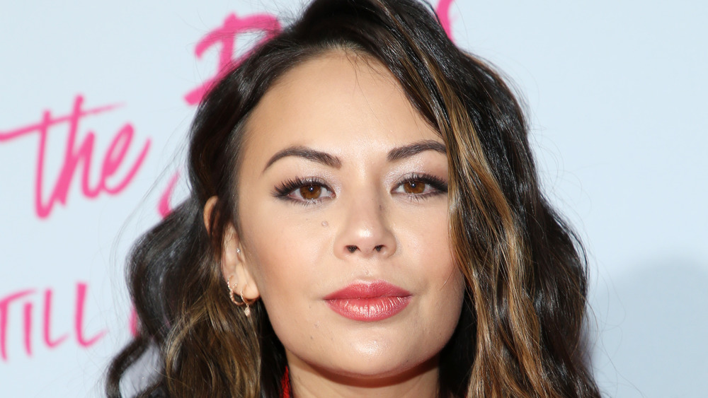 Janel Parrish wears red