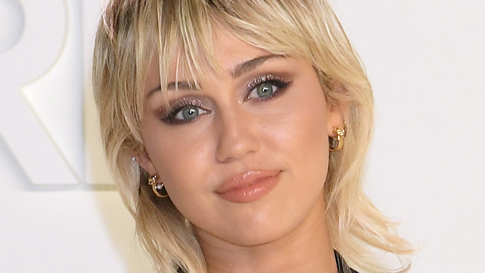 Miley Cyrus with glitter eyelashes