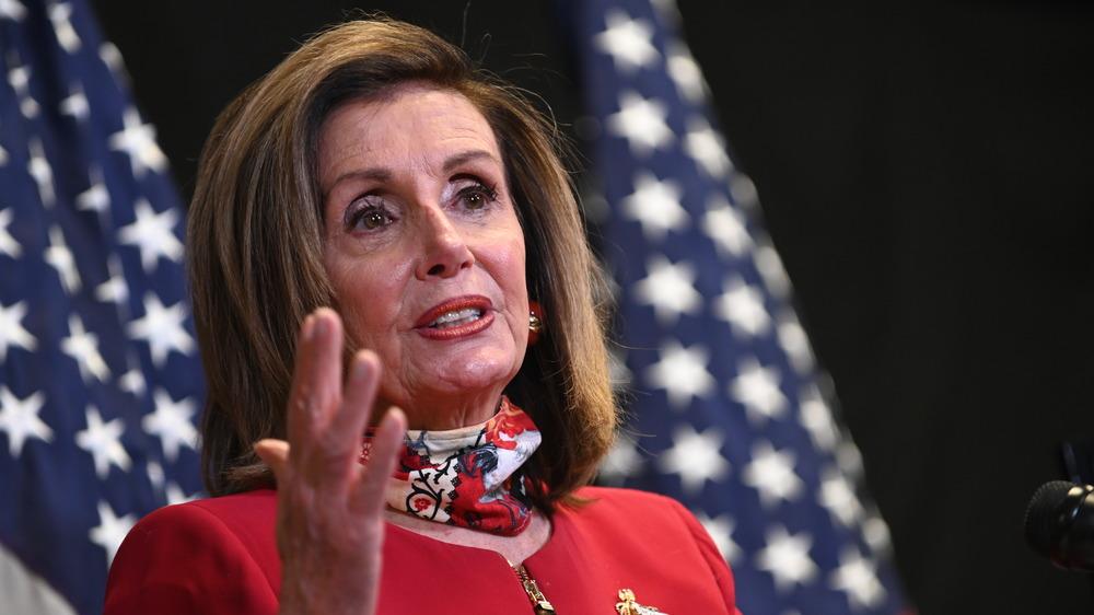 Nancy Pelosi in front of US flag
