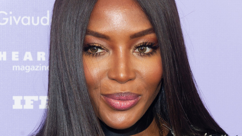 Naomi Campbell grinning with hair down