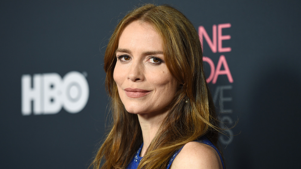 Saffron Burrows poses at an event