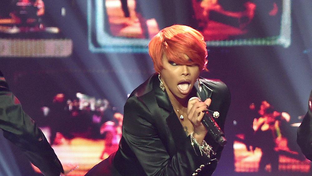 Pepa of Salt-N-Pepa singing on stage