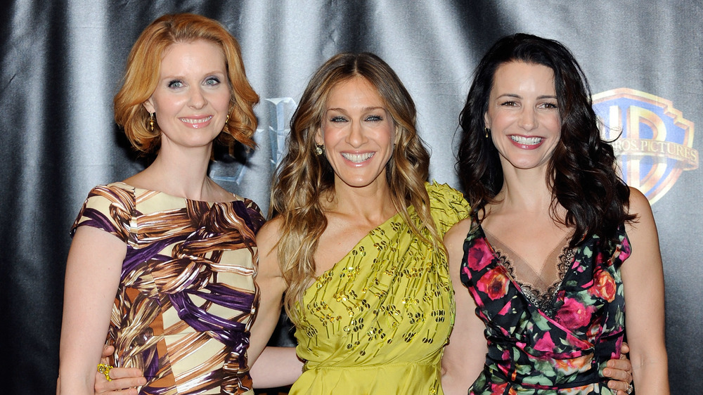 Sarah Jessica Parker, Kristin Davis, and Cynthia Nixon pose and smile