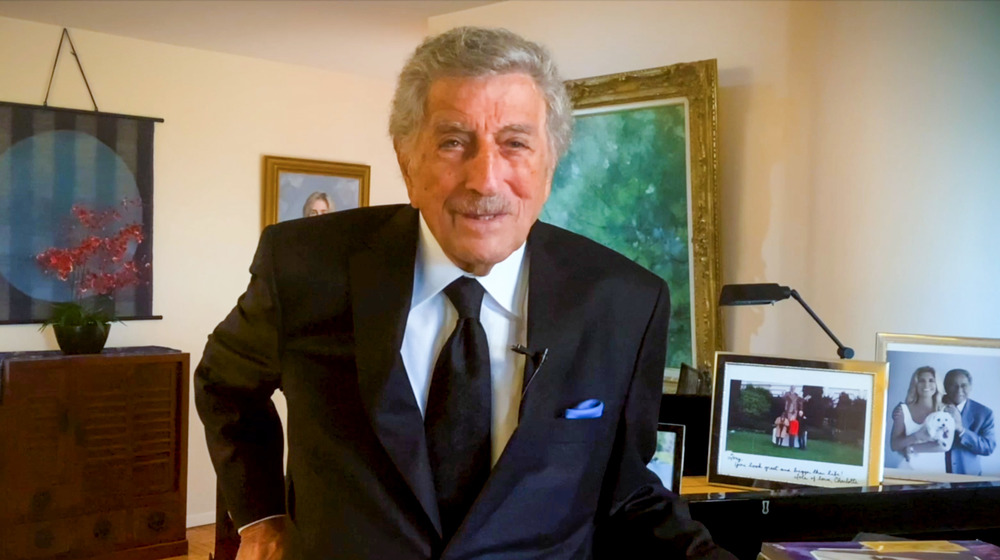 Tony Bennett standing by his piano