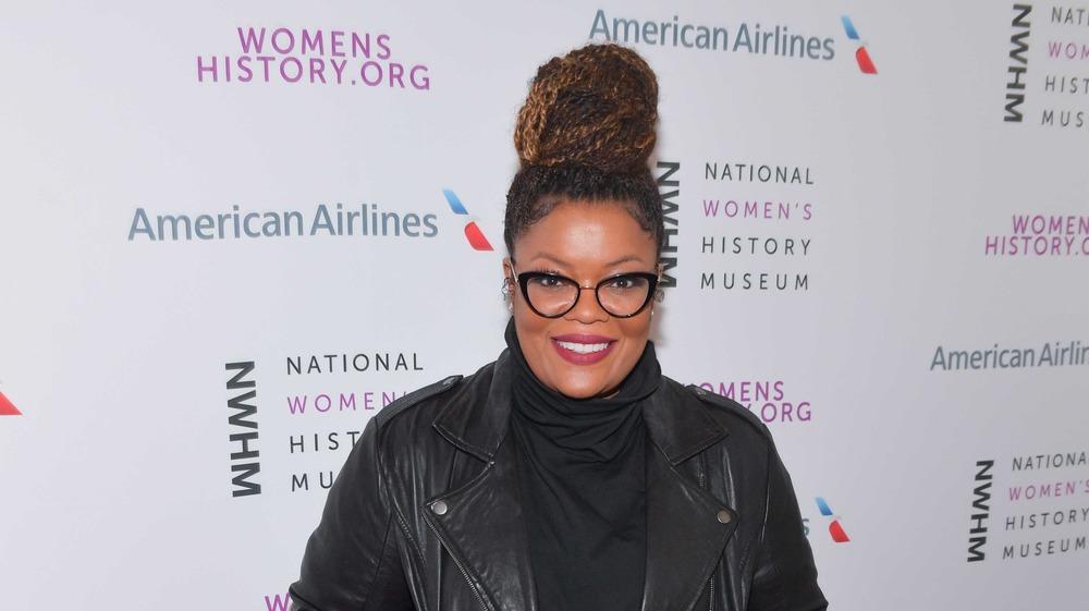 Yvette Nicole Brown smiling, wearing glasses